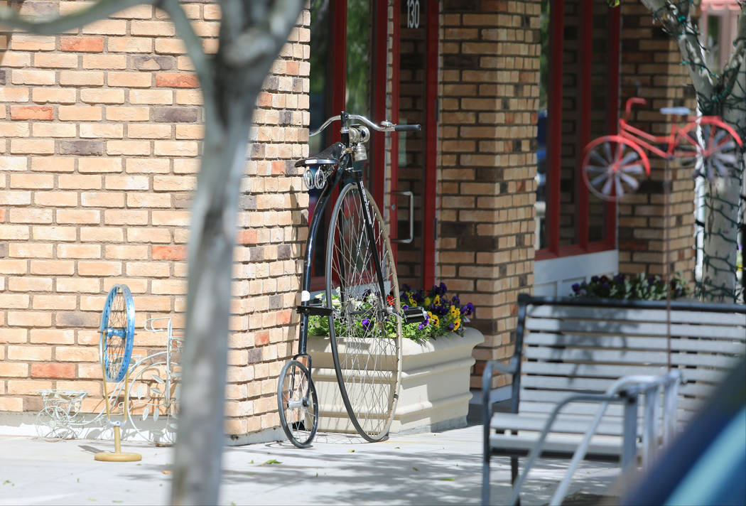A penny-farthing style bicycle stands out front of The Vault Bicycle Shop, a full service cycling store at The Villages of Centennial Springs in Las Vegas on Thursday, March 23, 2017. (Brett Le Bl ...