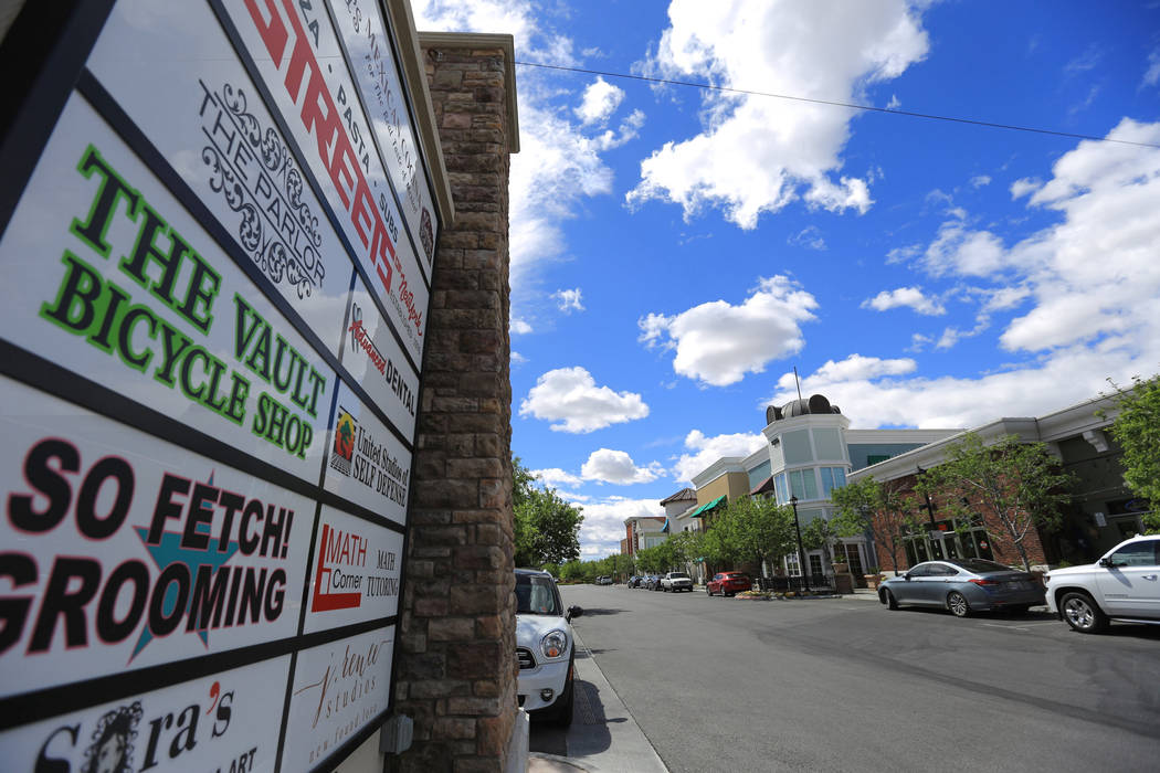 A sign advertising the businesses in The Villages of Centennial Springs stands at the entrance of the complex in Las Vegas on Thursday, March 23, 2017. (Brett Le Blanc/Las Vegas Review-Journal) @b ...
