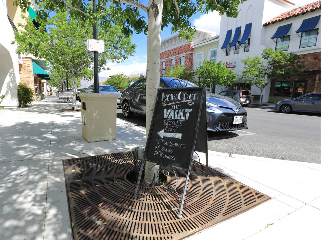 A sign for The Vault Bicycle Shop, a full service cycling store, sits in the sidewalk of The Villages of Centennial Springs in Las Vegas on Thursday, March 23, 2017. (Brett Le Blanc/Las Vegas Revi ...