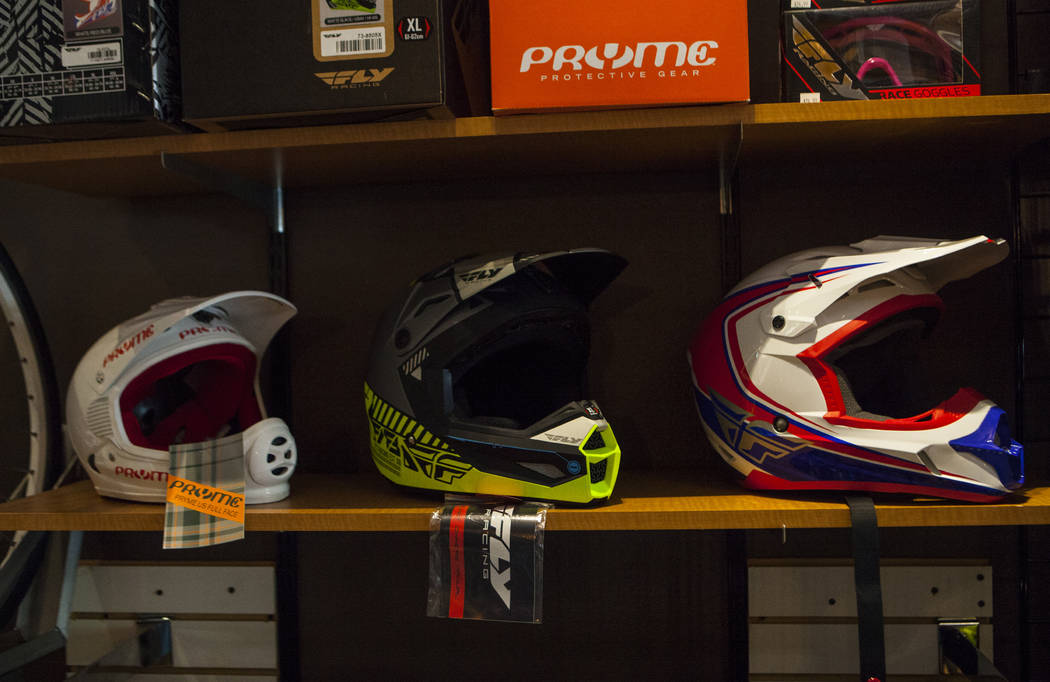 Helmets sit on a shelf at The Vault Bicycle Shop at the Village of Centennial Springs in Las Vegas on Saturday, April 1, 2017. (Miranda Alam/Las Vegas Review-Journal) @miranda_alam
