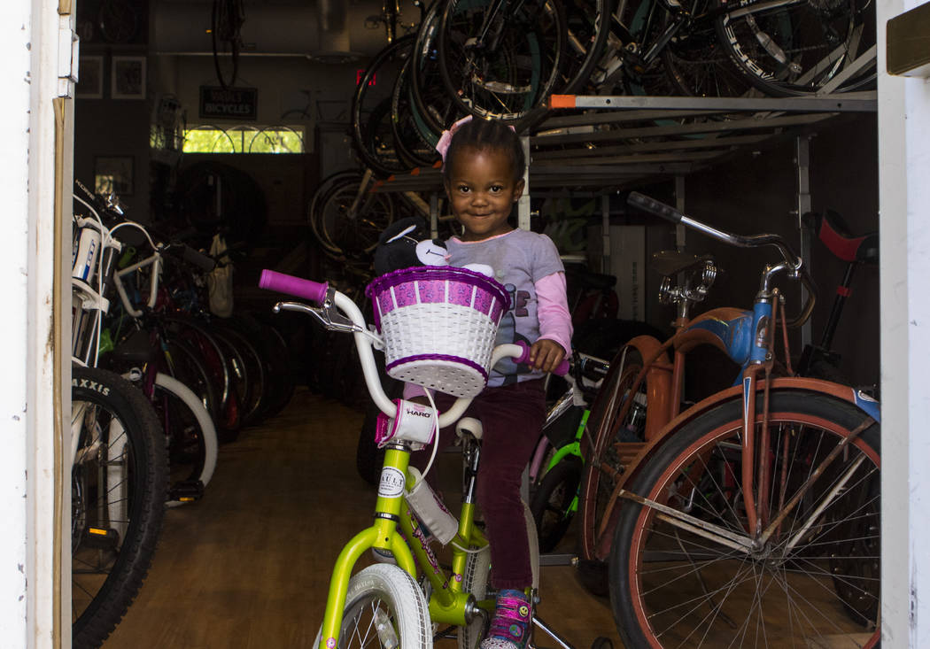 Neha Wilson, 3, sits on her bike featuring a new basket at The Vault Bicycle Shop at the Village of Centennial Springs in Las Vegas on Saturday, April 1, 2017. (Miranda Alam/Las Vegas Review-Journ ...