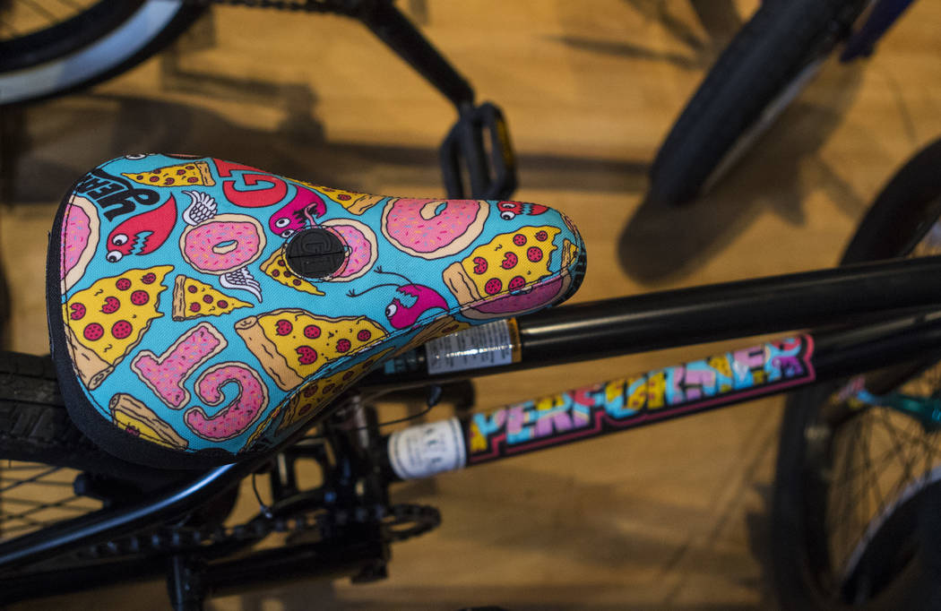 A bicycle seat with pizza and donuts on it at The Vault Bicycle Shop at the Village of Centennial Springs in Las Vegas on Saturday, April 1, 2017. (Miranda Alam/Las Vegas Review-Journal) @miranda_alam