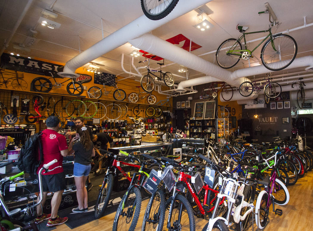 Lance Tanner, left, and Gracy Tanner get their inner tubes fixed at The Vault Bicycle Shop at the Village of Centennial Springs in Las Vegas on Saturday, April 1, 2017. (Miranda Alam/Las Vegas Rev ...