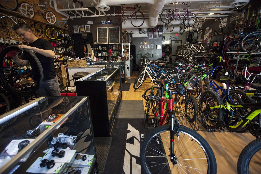 Owner Mike Skoy fixes a tire at The Vault Bicycle Shop at the Village of Centennial Springs in Las Vegas on Saturday, April 1, 2017. (Miranda Alam/Las Vegas Review-Journal) @miranda_alam