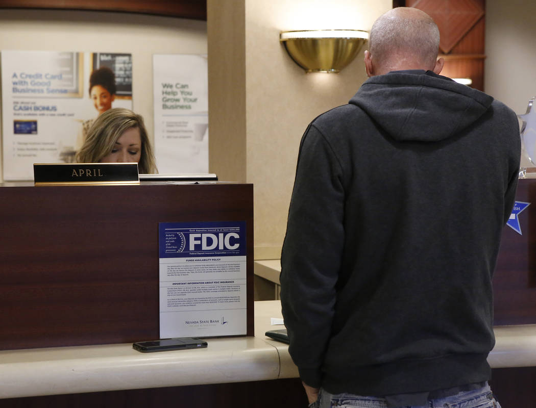 A bank teller assists a customer at the Nevada State Bank located at 750 E Warm Springs Rd on Thursday, March 23, 2017, in Las Vegas. (Christian K. Lee/Las Vegas Review-Journal) @chrisklee_jpeg