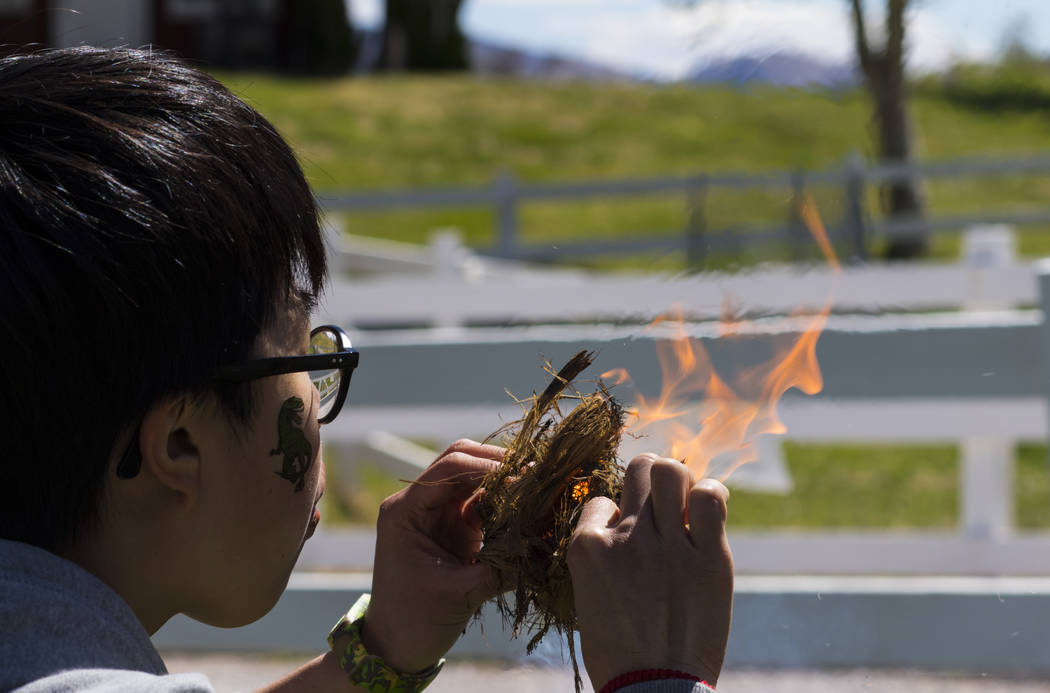 Winglaam Chiu of Hong Kong blows on an ember to create a flame during the Mojave Spring Fling Festival at Spring Mountain Ranch State Park on Saturday, April 1, 2017. (Miranda Alam/Las Vegas Revie ...