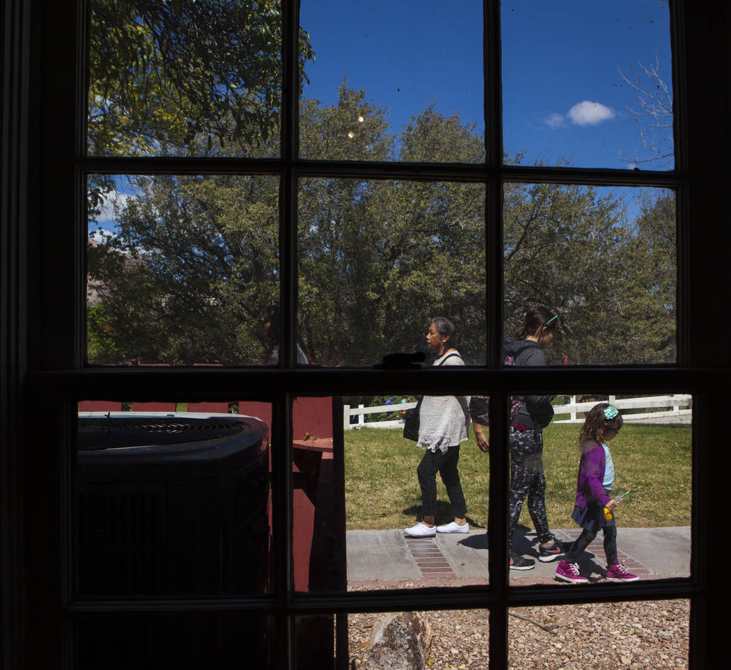 Visitors walk by a window outside of the main ranch house during the Mojave Spring Fling Festival at Spring Mountain Ranch State Park on Saturday, April 1, 2017. (Miranda Alam/Las Vegas Review-Jou ...
