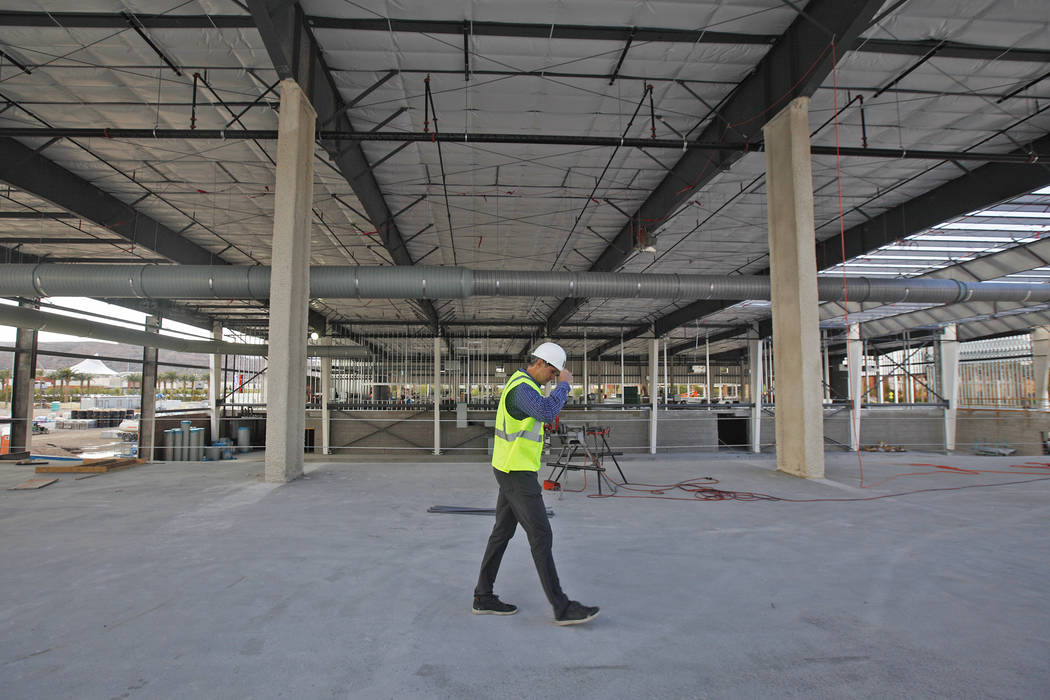 Murray Craven, vice president for the Golden Knights hockey team, walks through the future dining area at the team's practice facility construction site on Monday, March 27, 2017, in Las Vegas. (R ...