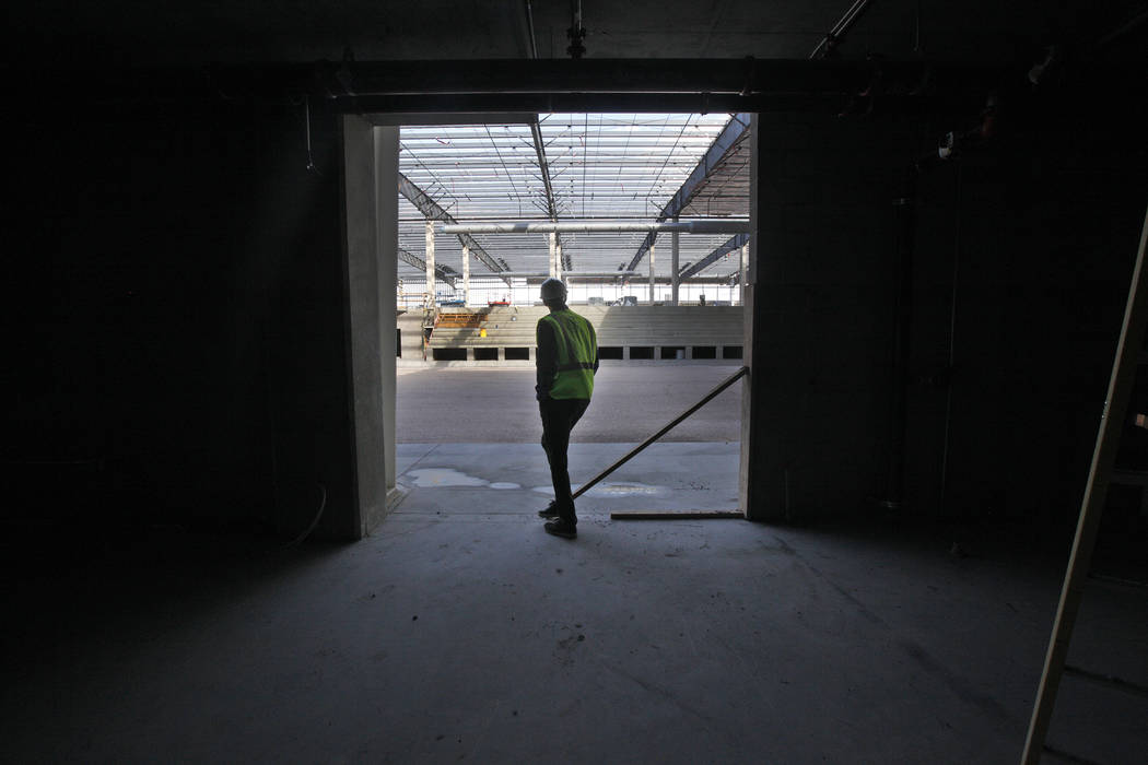 Murray Craven, vice president for the Golden Knights hockey team, enters the future ice rink from the locker rooms at the team's practice facility construction site on Monday, March 27, 2017, in L ...