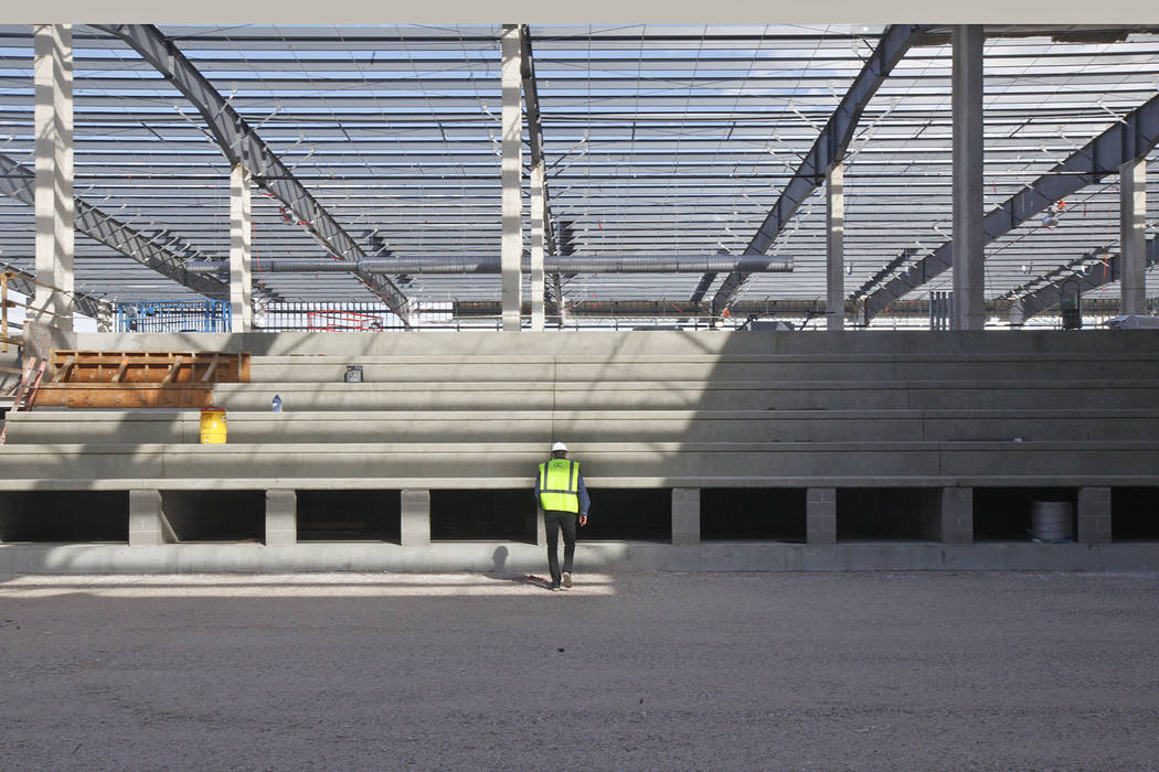 Murray Craven, vice president for the Golden Knights hockey team, walks across the future ice rink from the at the team's practice facility construction site on Monday, March 27, 2017, in Las Vega ...