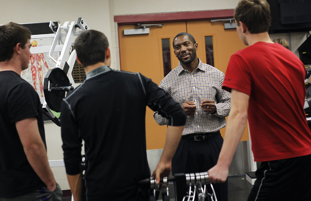 Head football coach Vernon Fox, second from right, talks with some of his players while hanging out in the weight room at Faith Lutheran High School in Las Vegas on Wednesday, Jan. 29, 2014. Fox,  ...