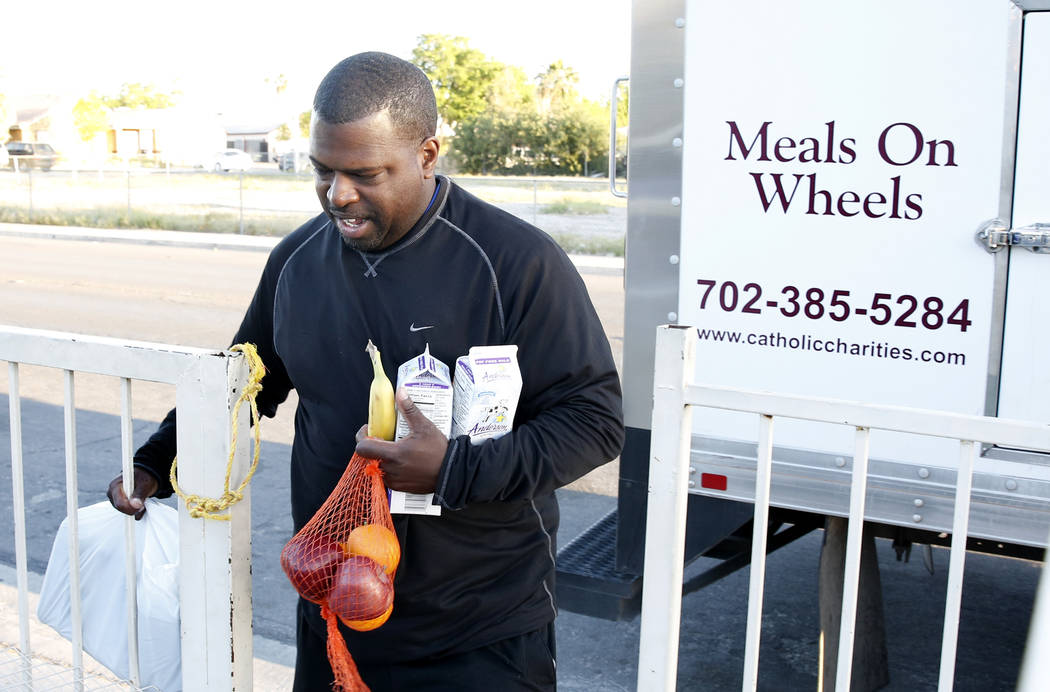 Meals on Wheels driver RaShawn Goston delivers meals to clients on Tuesday, March 29, 2017, in Las Vegas. Meals on Wheels is one of the programs where funding will likely be affected with Trump's  ...