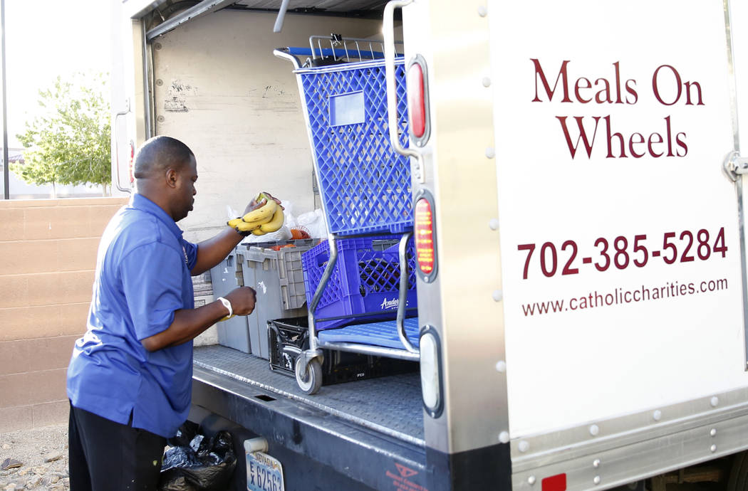 Meals on Wheels driver RaShawn Goston unloads bananas as he delivers meals to clients on Tuesday, March 29, 2017, in Las Vegas. Meals on Wheels is one of the programs where funding will likely be  ...