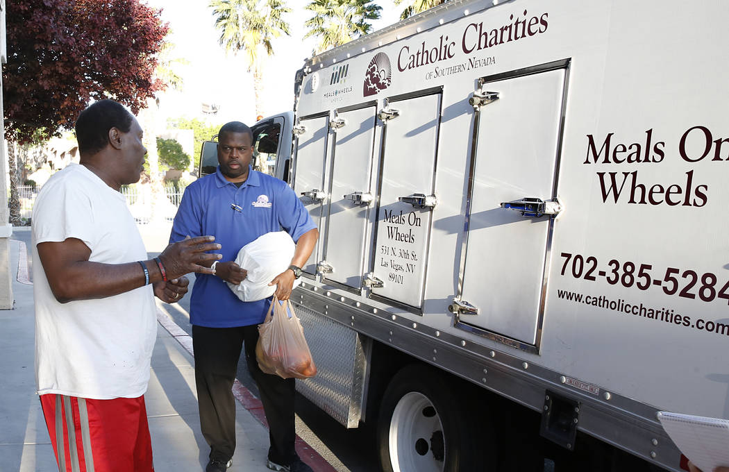 Meals on Wheels driver RaShawn Goston, right, delivers meals to Johnny Clarkon Tuesday, March 29, 2017, in Las Vegas. Meals on Wheels is one of the programs where funding will likely be affected w ...