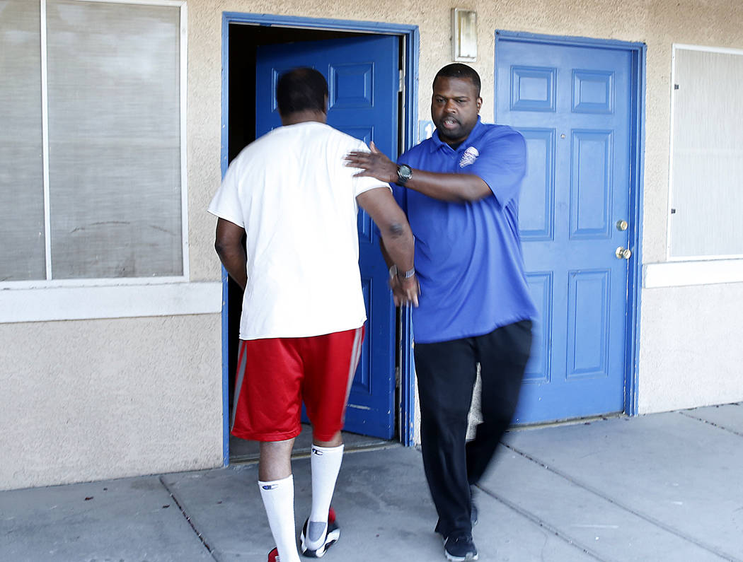 Meals on Wheels driver RaShawn Goston, right, shakes hands with Johnny Clarkon after delivering his meals Tuesday, March 29, 2017, in Las Vegas. Meals on Wheels is one of the programs where fundin ...