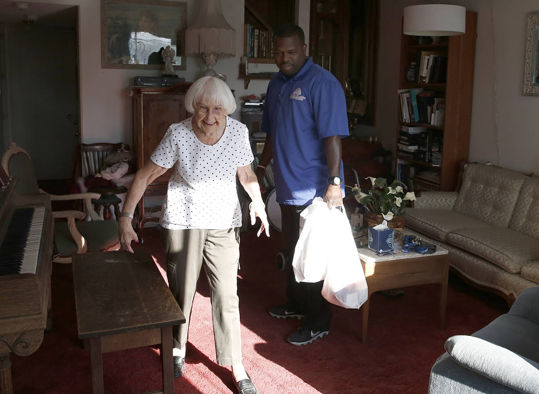 Meals on Wheels driver RaShawn Goston delivers meals to Rhoda Jones, 93, Tuesday, March 29, 2017, in Las Vegas. Meals on Wheels is one of the programs where funding will likely be affected with Tr ...