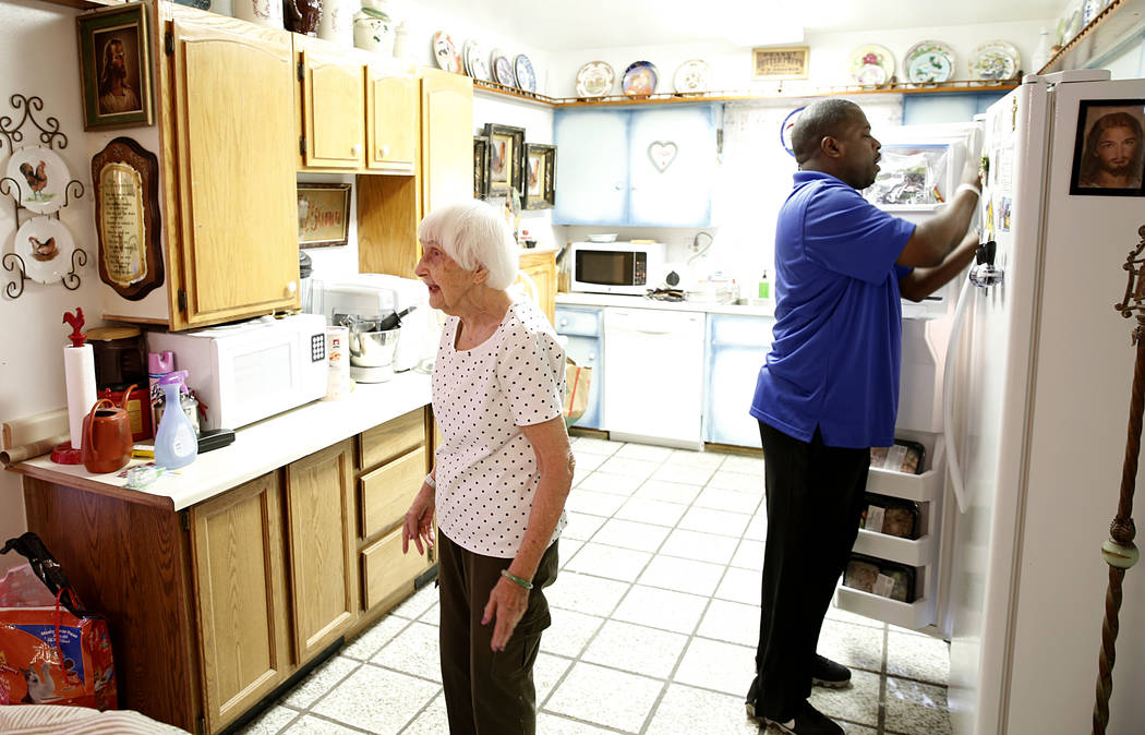 Meals on Wheels driver RaShawn Goston stores meals for Rhoda Jones, 93, Tuesday, March 29, 2017, in Las Vegas. Meals on Wheels is one of the programs where funding will likely be affected with Tru ...