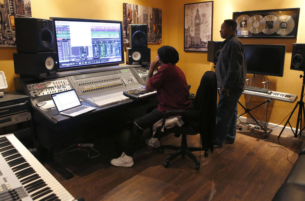Levant Marcus, from left, and Darry Lighten at the Digiworld Entertainment recording studio on Tuesday, March 28, 2017, in North Las Vegas. (Christian K. Lee/Las Vegas Review-Journal) @chrisklee_jpeg