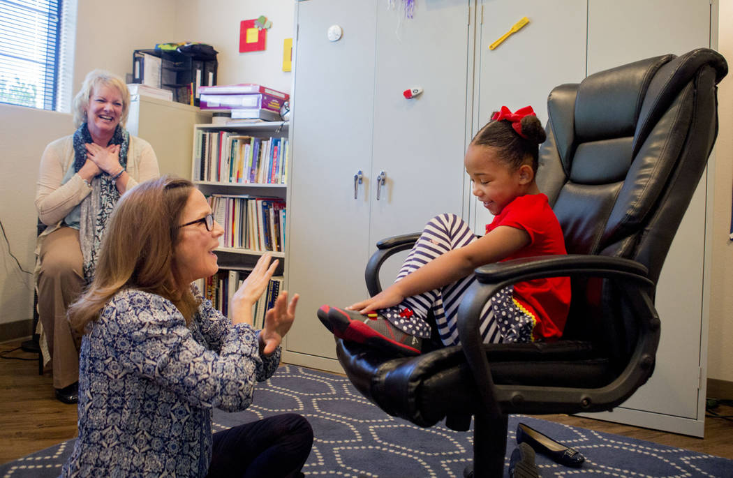 Client Hannah Beal, 4, and Julie Cole, a speech-language pathologist, engage in play therapy at the UNLV Medicine Ackerman Autism Center in Las Vegas, Wednesday, March 29, 2017, as Dr. Julie Beasl ...