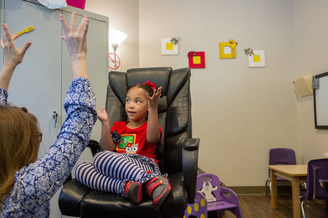 Client Hannah Beal, 4, and Julie Cole, a speech-language pathologist, engage in play therapy at the UNLV Medicine Ackerman Autism Center in Las Vegas, Wednesday, March 29, 2017. (Elizabeth Brumley ...