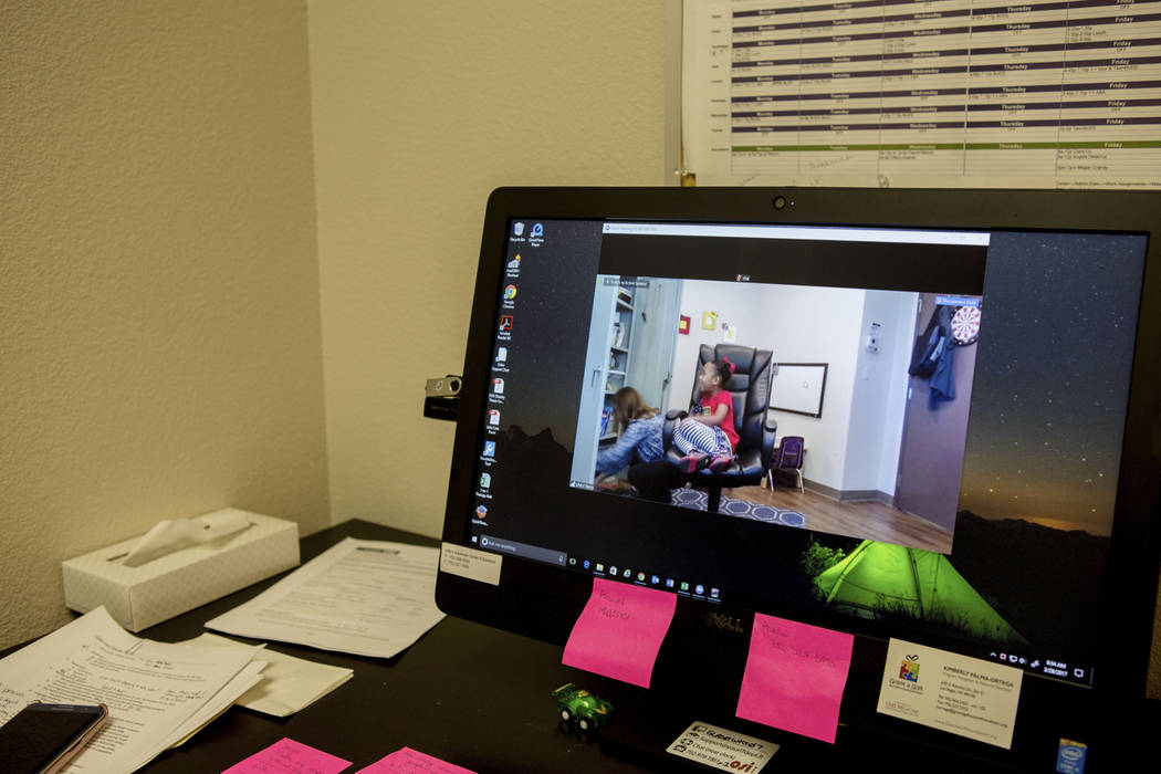 A video monitor shows client Hannah Beal, 4, engaging in play therapy at the UNLV Medicine Ackerman Autism Center in Las Vegas, Wednesday, March 29, 2017. (Elizabeth Brumley/Las Vegas Review-Journ ...