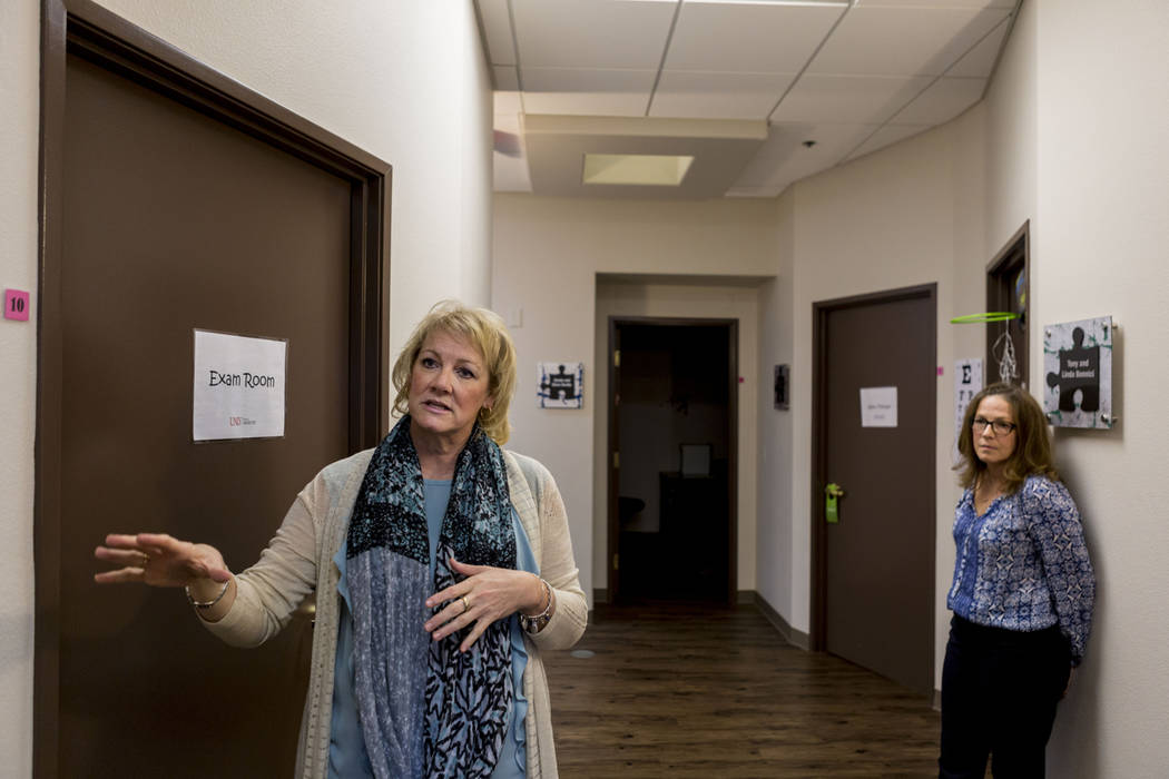 Dr. Julie Beasley, left, and Julie Cole, a speech-language pathologist, discuss the facility at the UNLV Medicine Ackerman Autism Center in Las Vegas, Wednesday, March 29, 2017. (Elizabeth Brumley ...