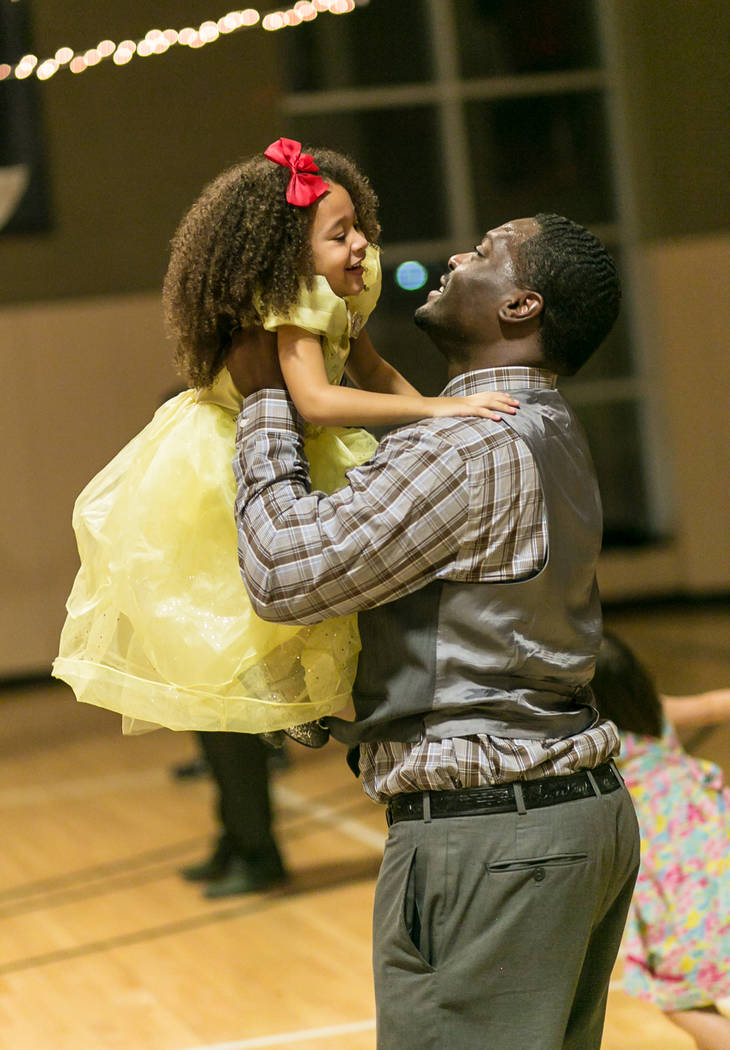 """A father and his daughter at the """"Belle of the Ball"""" event at Life Time Athletic Green Valley on Feb. 18. 2017. (Jeff Ragazzo)"""