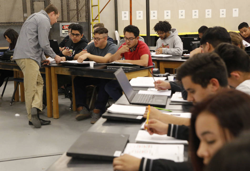 Alex Bechtler, left, assists students during a manufacturing class at the Southeast Career and Technical Academy on Wednesday, March 29, 2017, in Las Vegas. (Christian K. Lee/Las Vegas Review-Jour ...