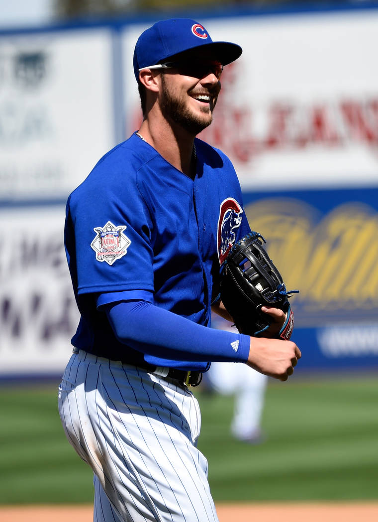 Chicago Cubs third baseman Kris Bryant (17) smiles at the end of an inning during an exhibition game against the Cincinnati Reds at Cashman Field on Sunday, March 26, 2017, in Las Vegas. David Bec ...
