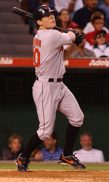 Baltimore Orioles' Marty Cordova follows through on a double to right field against the Anaheim Angels in the sixth inning, Thursday, July 4, 2002, in Anaheim, Calif.(AP Photo/John Hayes)