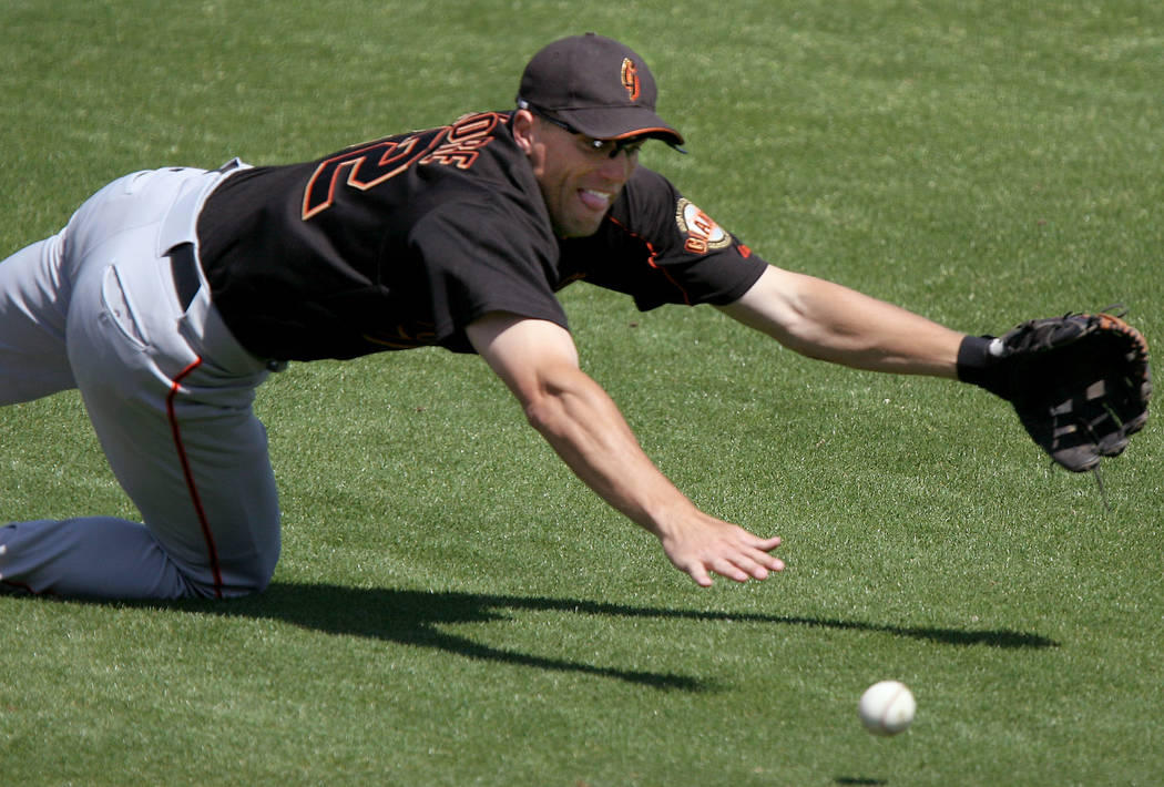 San Francisco Giants second baseman Brian Dallimore attemps to field a groundball hit for a single by Los Angeles Angels' Garret Anderson in the first inning of a spring training game, Wednesday,  ...