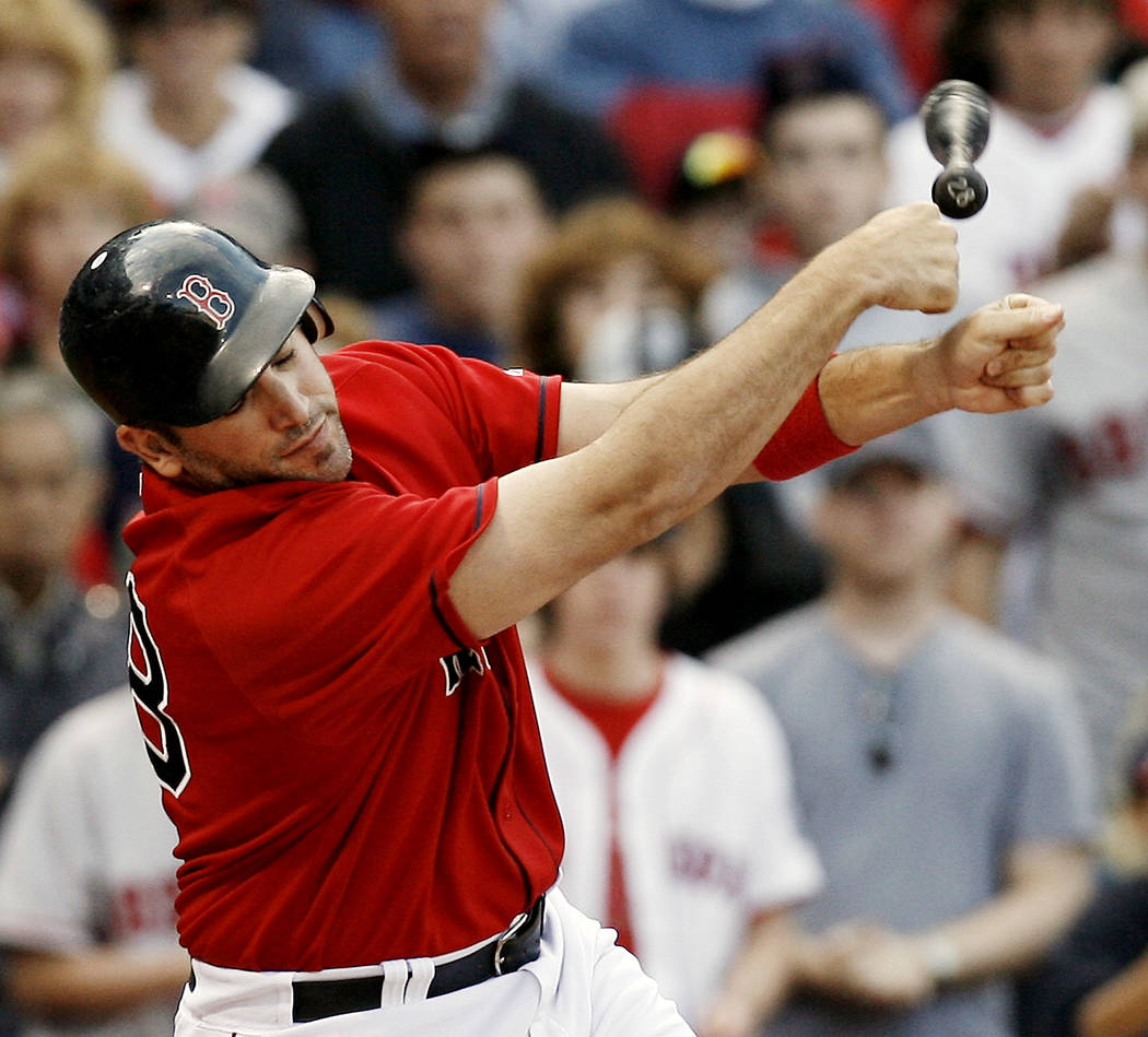 Boston Red Sox's Doug Mirabelli loses his bat while swinging and missing at a pitch during the ninth inning of Boston's 3-2 loss to the Minnesota Twins in a baseball game at Fenway Park in Boston  ...