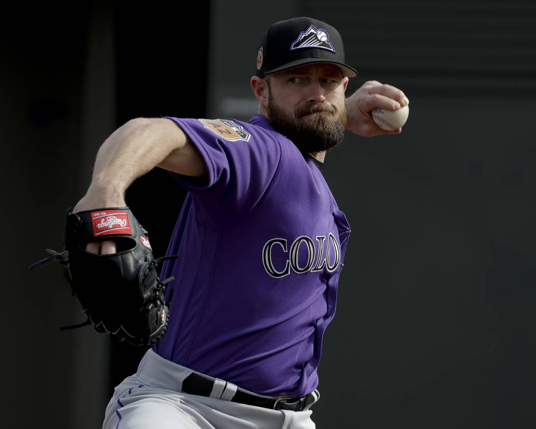 Colorado Rockies relief pitcher Mike Dunn throws during spring baseball practice in Scottsdale, Ariz., Friday, Feb. 17, 2017. (AP Photo/Chris Carlson)