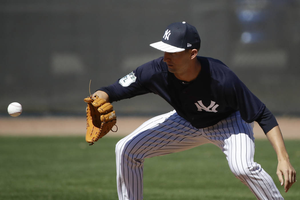New York Yankees' Chasen Shreve catches a ball during a spring training baseball workout Friday, Feb. 17, 2017, in Tampa, Fla. (AP Photo/Matt Rourke)