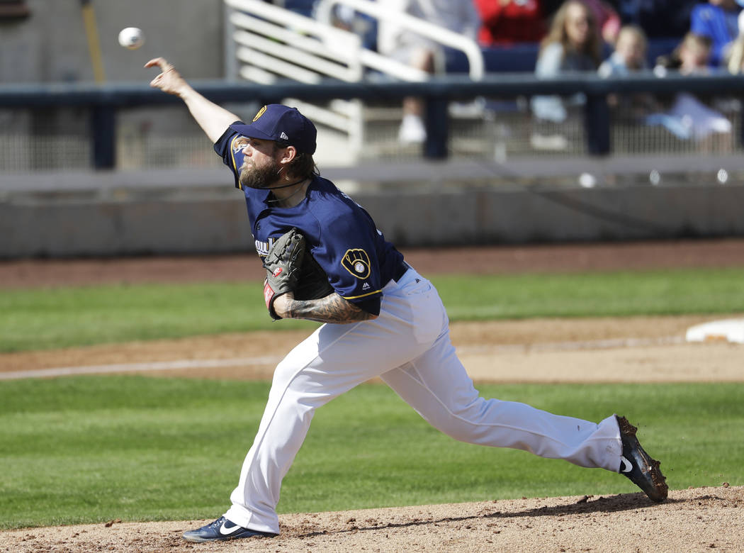 Milwaukee Brewers' Michael Blazek throws during the fourth inning of a spring training baseball game against the Kansas City Royals Tuesday, Feb. 28, 2017, in Phoenix. (AP Photo/Morry Gash)