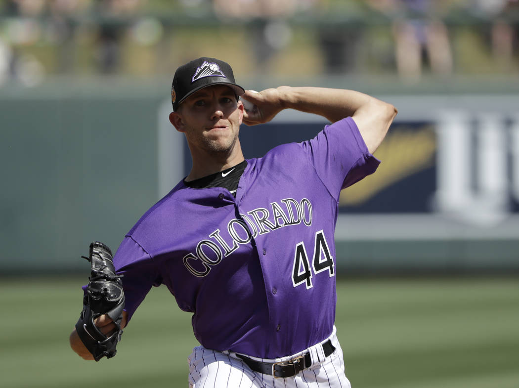 Colorado Rockies' Tyler Anderson throws during a spring training baseball game against the Chicago Cubs, Monday, March 20, 2017, in Scottsdale, Ariz. (AP Photo/Darron Cummings)