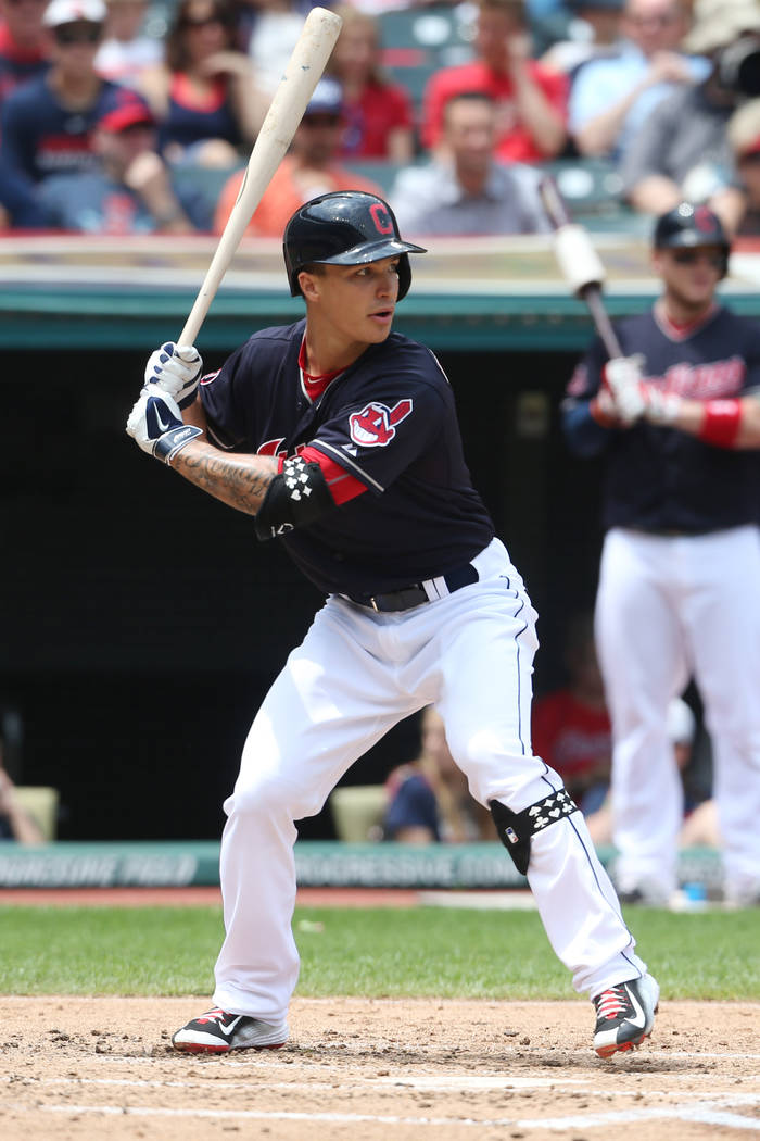 Cleveland Indians' Zach Walters hits an RBI single off Seattle Mariners starting pitcher J.A. Happ during the second inning of a baseball game, Thursday, June 11, 2015, in Cleveland. (AP Photo/Ron ...
