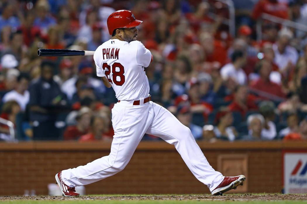 St. Louis Cardinals' Tommy Pham hits a double during the sixth inning of a baseball game against the Cincinnati Reds, Tuesday, Aug. 9, 2016, in St. Louis. The Reds won 7-4. (AP Photo/Billy Hurst)