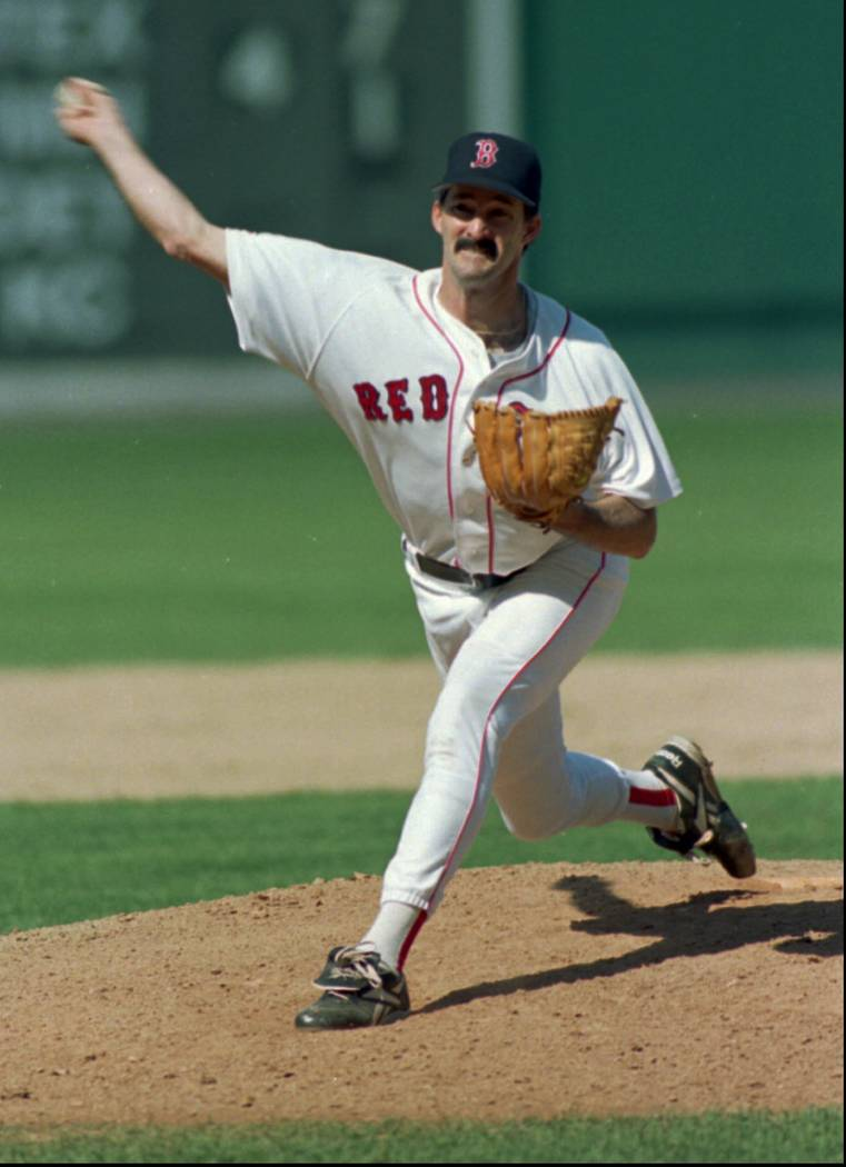 Boston Red Sox winning starting pitcher Mike Maddux delivers a throw against the Seattle Mariners in the sixth inning of American League play at Boston's Fenway Park Sunday, Aug. 25, 1996.  Boston ...