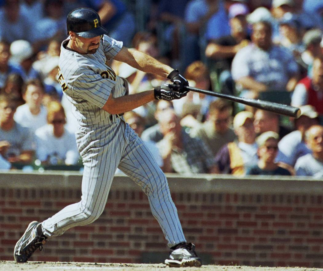Pittsburgh Pirates' Chad Hermansen hits his first major league home run during the second inning Sunday, Sept. 26, 1999, in Chicago against the Cubs.  (AP Photo/Stephen J. Carrera)
