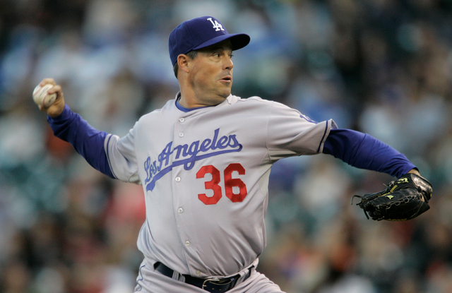 Los Angeles Dodgers' Greg Maddux pitches to the San Francisco Giants in the first inning of a baseball game in San Francisco, Saturday, Sept. 27, 2008. The Dodgers won 2-1. (AP Photo/Jeff Chiu)