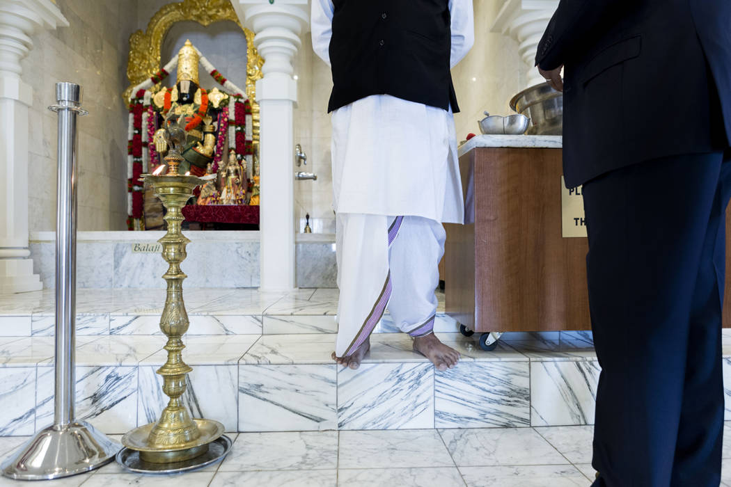 Nevada Equal Rights Commissioner Swadeep Nigam, left, receives a blessing from priest Pandit Brijesh Raval at the Hindu Temple of Las Vegas in Las Vegas, Wednesday, March 29, 2017. (Elizabeth Brum ...