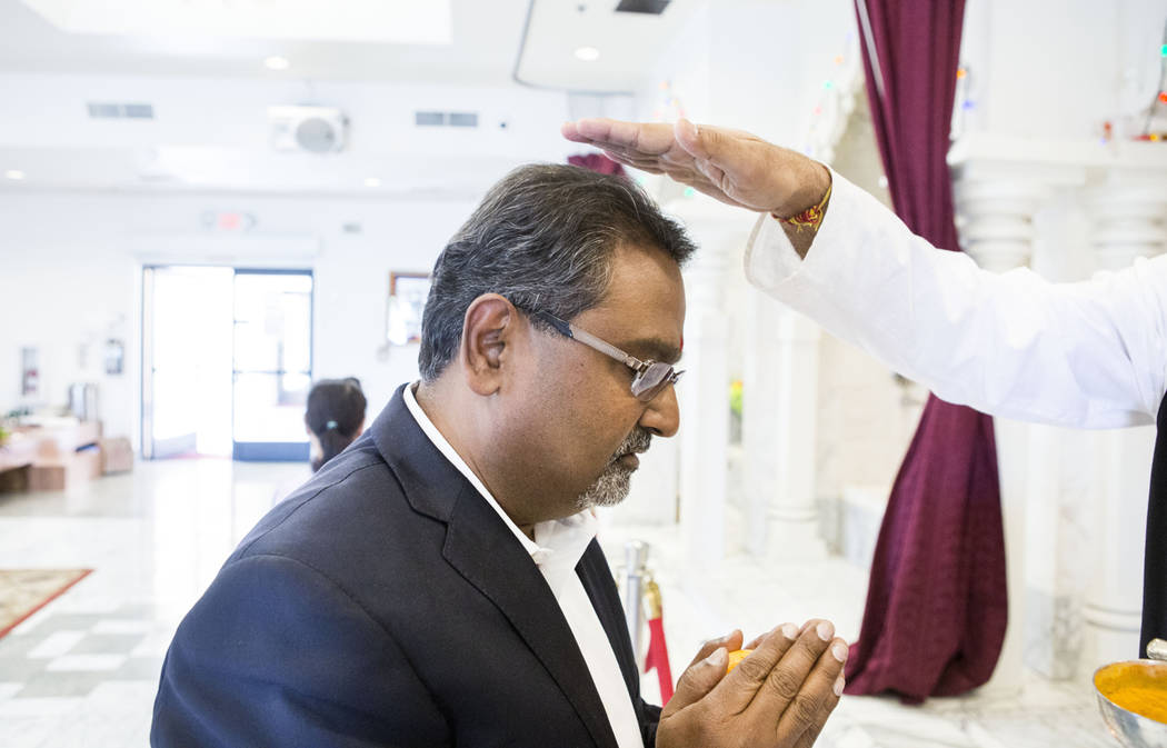Nevada Equal Rights Commissioner Swadeep Nigam receives a blessing from priest Pandit Brijesh Raval at the Hindu Temple of Las Vegas in Las Vegas, Wednesday, March 29, 2017. (Elizabeth Brumley/Las ...