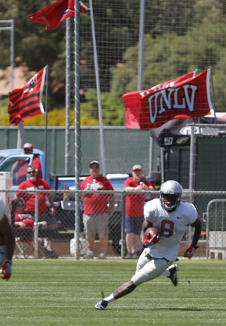 UNLV's Charles Williams (8) runs the ball during a UNLV spring football exhibition at the Peter Johann Memorial Field on Saturday, April 1, 2017, in Las Vegas. (Christian K. Lee/Las Vegas Review-J ...