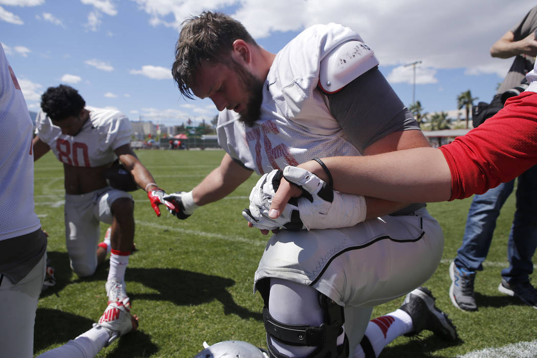 UNLV's Kyle Saxelid (76) and his teammates pray after a UNLV spring football exhibition at the Peter Johann Memorial Field on Saturday, April 1, 2017, in Las Vegas. (Christian K. Lee/Las Vegas Rev ...