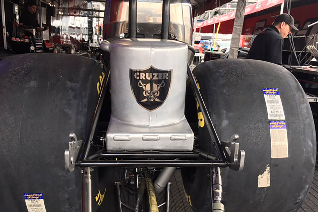 "NHRA Funny Car driver Cruz Pedregon shows his allegiance to the NFL's Raiders with an oil catch can. ""They deserve a really nice, modern stadium where the fans can go and enjoy Raider football,  ..."