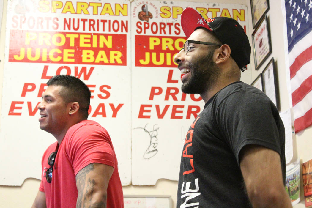 Spartan Sports Nutrition owner, Abid Mamdani, left, shares a joke with Kim, right, while things are slow during business hours, Wednesday, March 29, 2017. (Gabriella Benavidez/Las Vegas Review-Jou ...