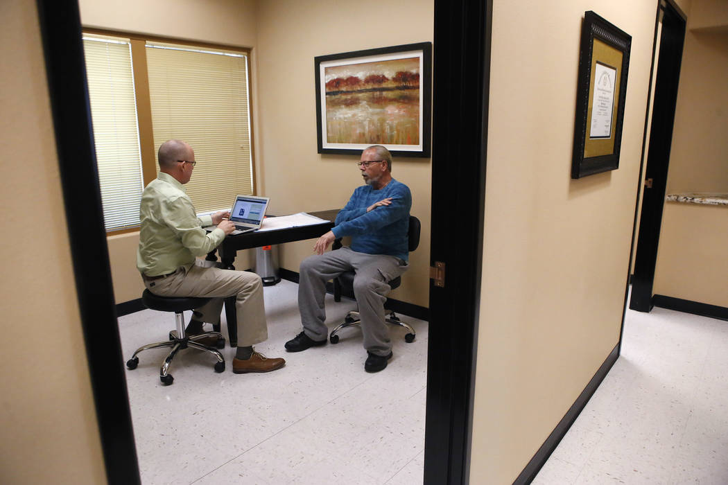 Dr. Tim Tollestrup, left, talks with Mark Kline Wednesday, March 29, 2017, in Henderson. Tollestrup performed a surgery on Kline's knee. (Christian K. Lee/Las Vegas Review-Journal) @chrisklee_jpeg