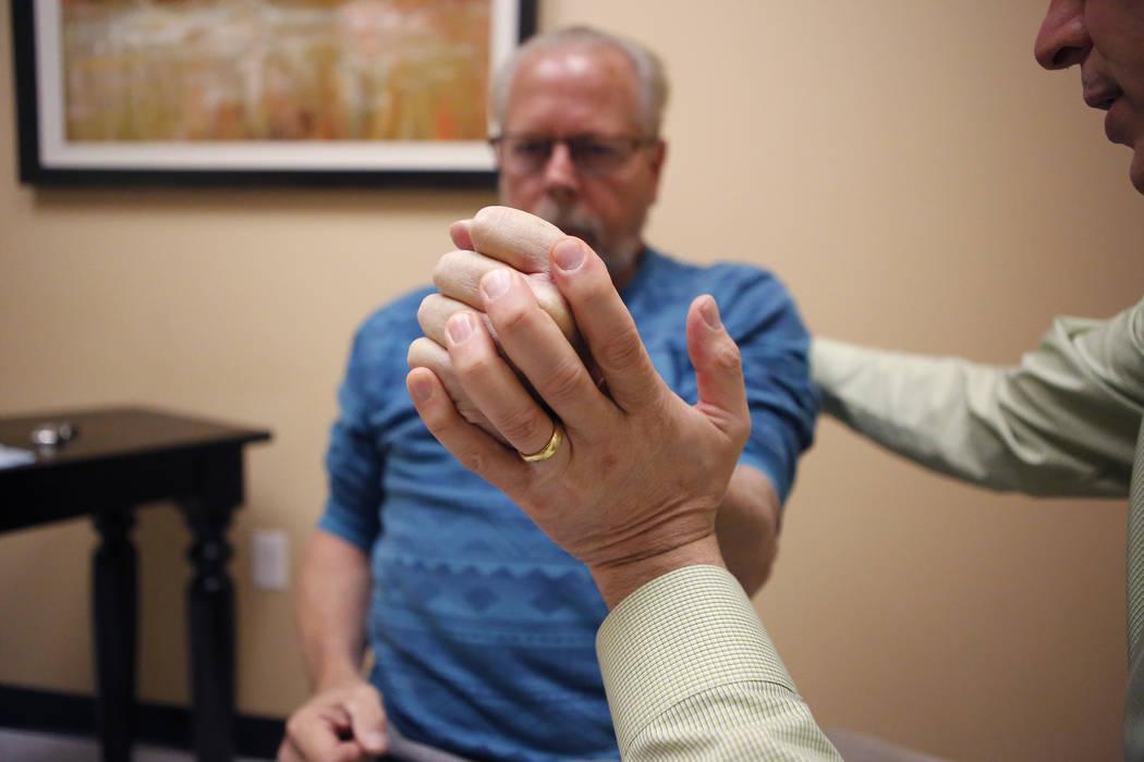 Dr. Tim Tollestrup, right, performs a nerve evaluation on Mark Kline on Wednesday, March 29, 2017, in Henderson. Kline is his patient. (Christian K. Lee/Las Vegas Review-Journal) @chrisklee_jpeg
