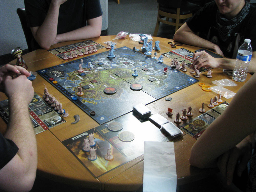 """Customers play a game of """"Blood Rage"""" at Meepleville, 4704 W. Sahara Ave. (F. Andrew Taylor/View) @FAndrewTPress"""